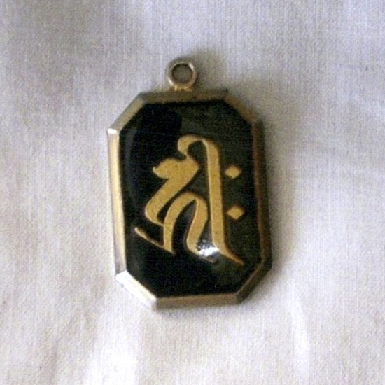 Share International September 2014 images, Zenkoji temple amulet: half of it had changed into gold