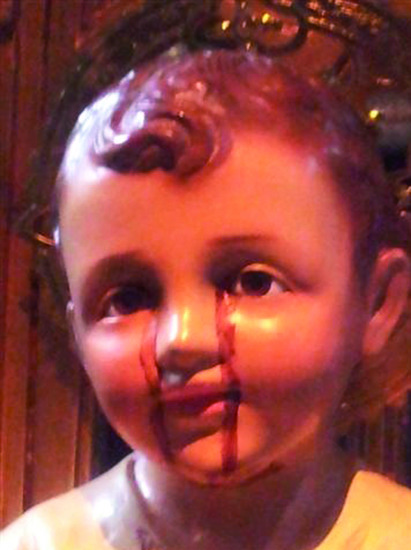 Share International December 2014 images, Infant Jesus statue in Israel sheds tears of blood. This is a miracle manifested by a senior disciple of the Master Jesus