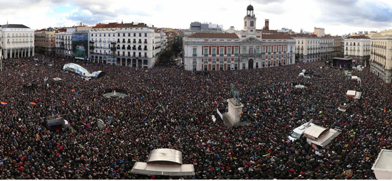 Share International March 2015 images, 'March for change' in Madrid.
