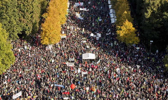 Share International November 2015 images, At least 150,000 people marched in Berlin on 10 October 2015 in protest against the Transatlantic Trade and Investment Partnership (TTIP) free trade deal between Europe and the United States that they say is anti-democratic and will lower food safety, labour and environmental standards.