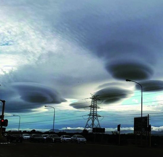 Share International December 2015 images, Benjamin Creme's Master confirms that the Cape Town UFO 'clouds' were craft from various planets. It is another example of the co-ordinated work from various planets.
