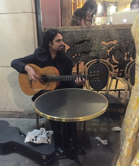 Share International July / August 2016 images, Benjamin Creme's Master confirms that this is Maitreya in the guise of a guitarist playing a beautiful, and joyful melody.