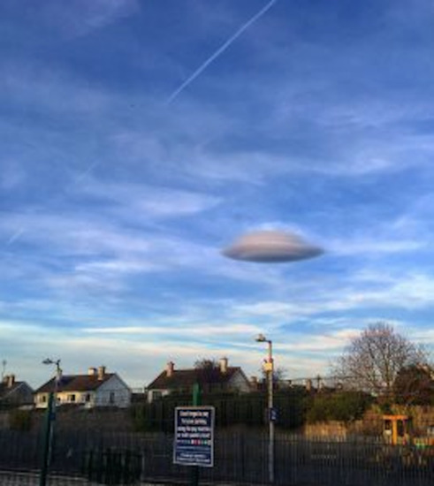 Share International May 2017 images, Greg MacLennan and his wife were out for a drive in Carlow, Ireland, when they observed and photographed a large, stationary UFO-like cloud over the town