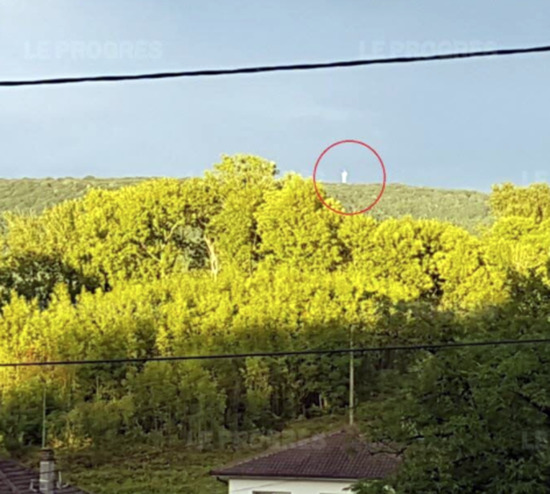 Share International October 2017 images, The white figure which was reminiscent of the statue of Christ the Redeemer, in Rio de Janeiro, Brazil, appeared on a hill near Perrigny, France, which is visible from Lons-le-Saulnier, on 11 August 2017 in the afternoon.