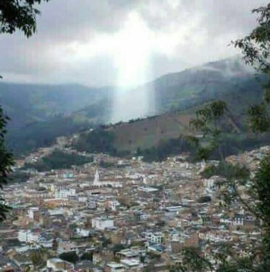 Share International December 2017 images, A luminous shaft of light in the sky appeared over the city of Manizales, Colombia, in late April 2017.