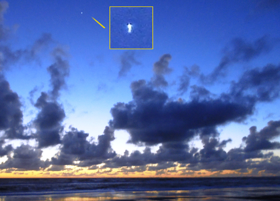 Share International November 2018 images, This photograph from 1 October 2018, shows an angel-like object in the sky above the sea, near the Manawatu district of New Zealand